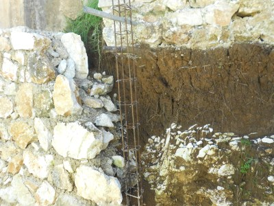 Eroding foundation at orphanage with start of a retaining wall.